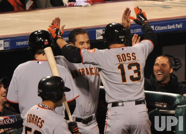 Giants' Cody Ross connects for a homerun during Game 1 of the NLCS in Philadelphia