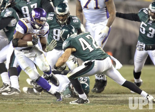 Vikings Adrian Peterson goes up the middle to Philadelphia 45-yard line