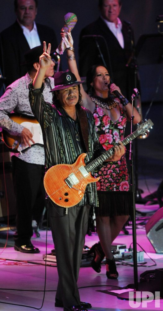 Carlos Santana and Lila Downs perform at Dolores Huerta's 80th birthday celebration in Los Angeles