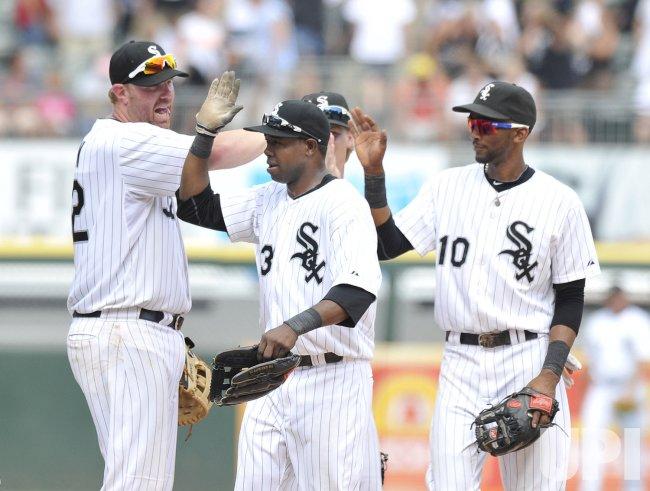 White Sox's Dunn, De Aza and Ramirez celebrate win over Tigers in Chicago
