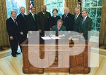 PRESIDENT BUSH SIGNS BILL INTO LAW IN OVAL OFFICE