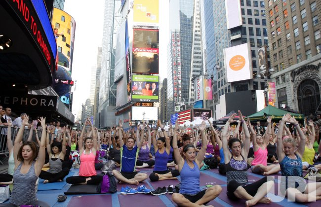 Thousands Practice Yoga in Times Square to Mark the Summer Solstice in New York City