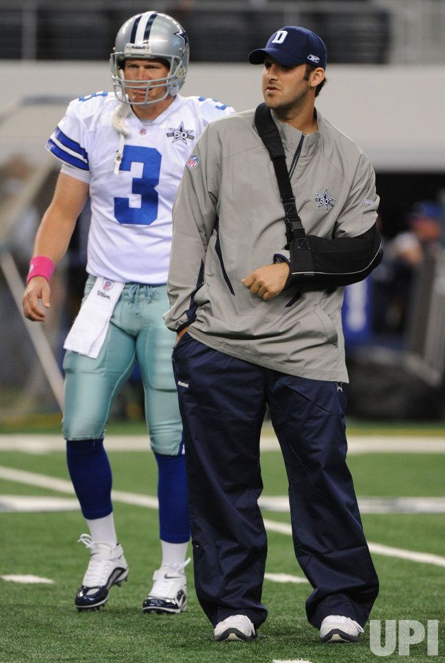 Cowboys' quarterback Tony Romo stands next to backup Jon Kitna in Texas
