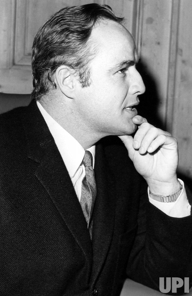 MARLON BRANDO SPEAKING AT A PRESS CONFERENCE