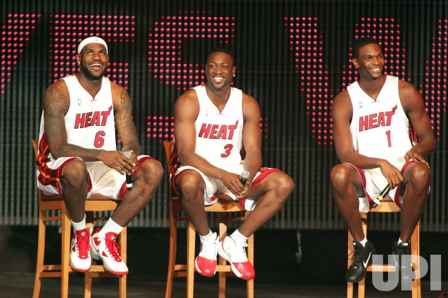 The Miami Heat sign LeBron James, Chris Bosh, and Dwyane Wade in Miami