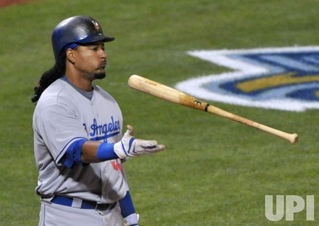 Los Angeles's Manny Ramirez tosses his bat during game three of the NLCS in Philadelphia