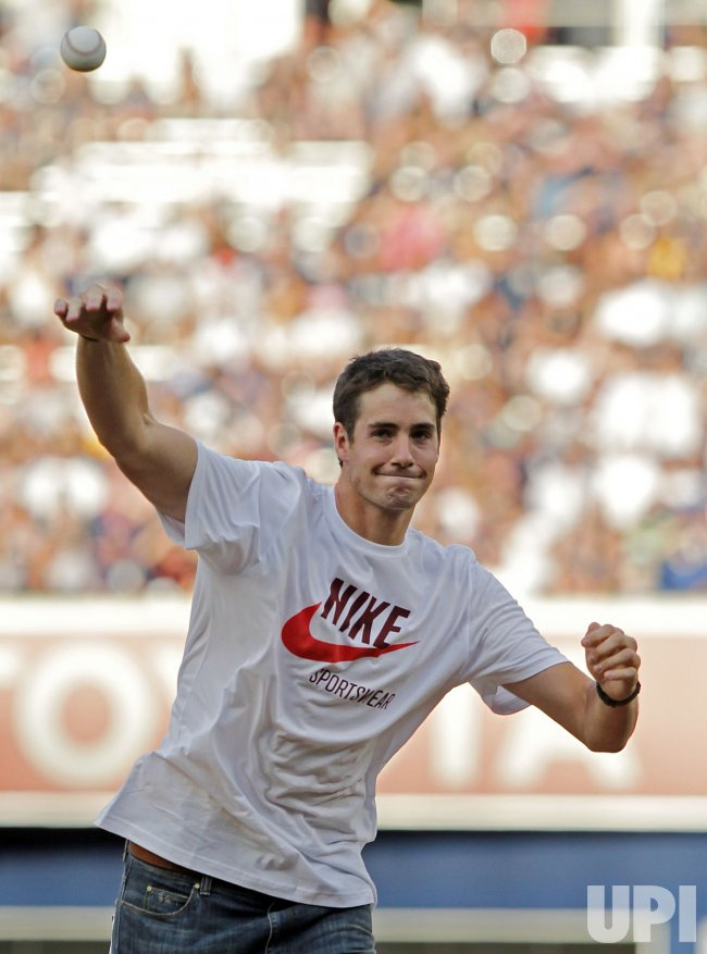 Tennis star John Isner throws out the first pitch at Yankee Stadium in New York
