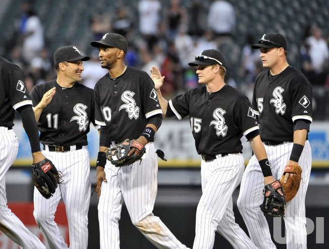 White Sox's Vizquel, Ramirez, Beckham, McPherson celebrate win over Dodgers in Chicago