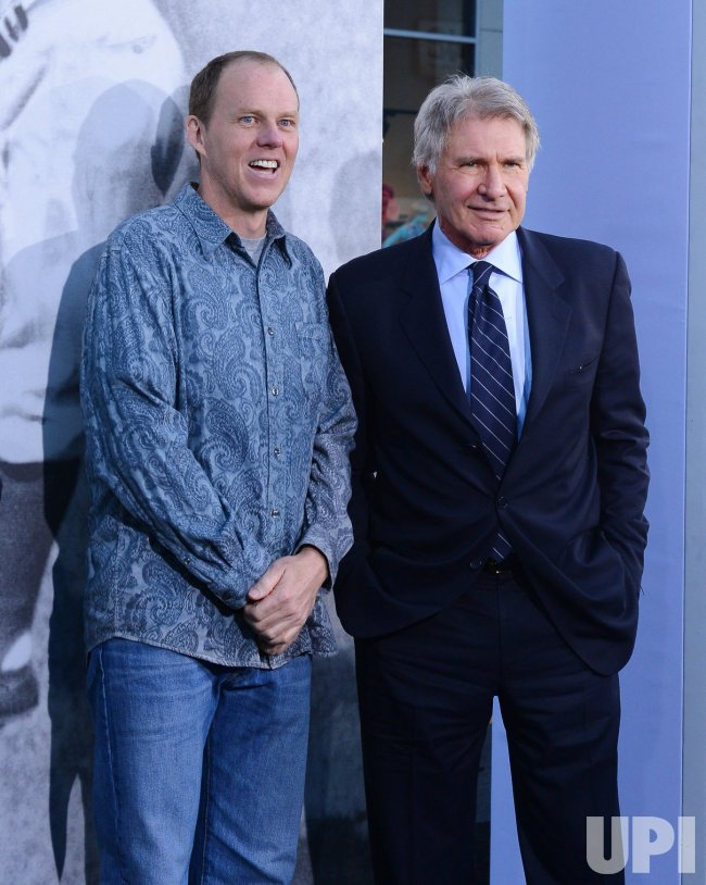 "Harrison Ford and Brian Helgeland attend the ""42"" premiere in Los Angeles"