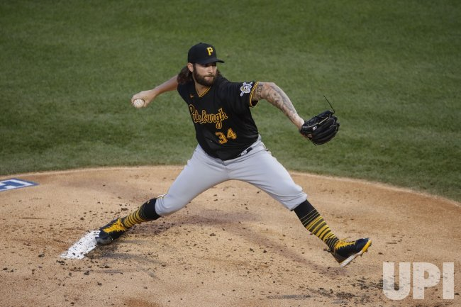Pirates starting pitcher Trevor Williams delivers against Cubs at Wrigley Field in Chicago