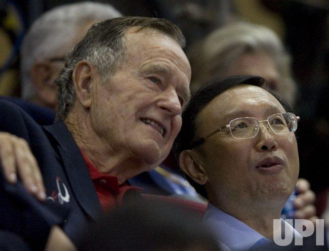 Former President Bush Sr. attends Olympic basketball game in Beijing