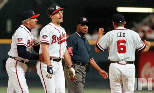 Smoltz restrained during argument with umpire