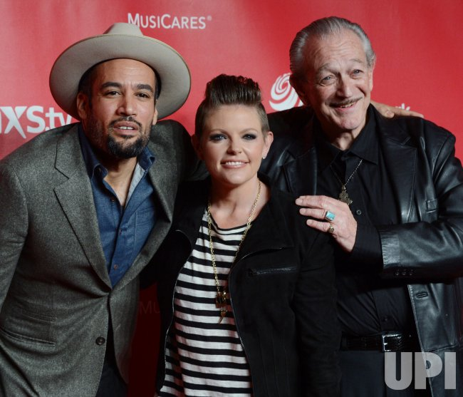 Ben Harper, Natalie Maines and Charlie Musselwhite arrive at 2013 MusiCares Person of the Year gala in Los Angeles