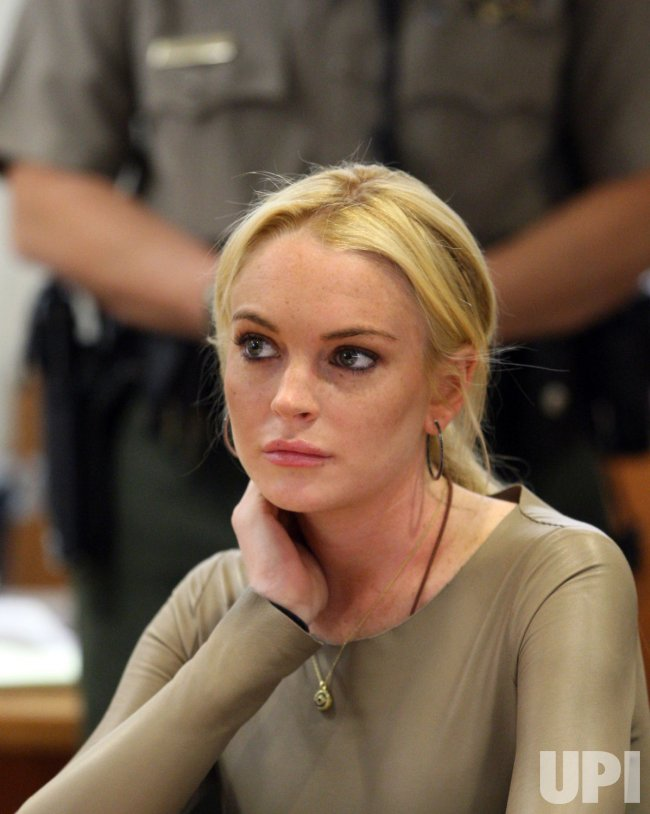 Lindsay Lohan rejects plea agreement in grand theft case in Los Angeles