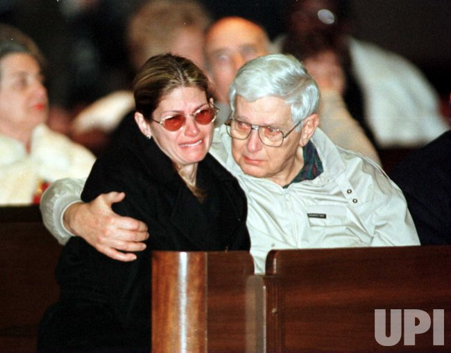 Mary Bono, the fourth wife of popular entertainer and politician Sonny Bono is consoled