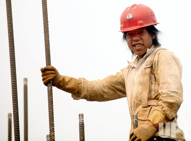 Chinese man works on construction site in Beijing