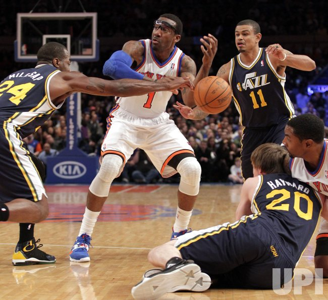 New York Knicks Amar'e Stoudemire, Utah Jazz Paul Millsap (24), Earl Watson (11) and Gordon Hayward at Madison Square Garden in New York