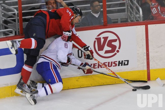 Capitals Steckel and Canadiens Spacek dive after the puck in Washington