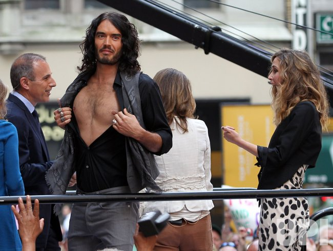 Rose Byrne reacts when Russell Brand opens up his shirt at Rockefeller Center in New York