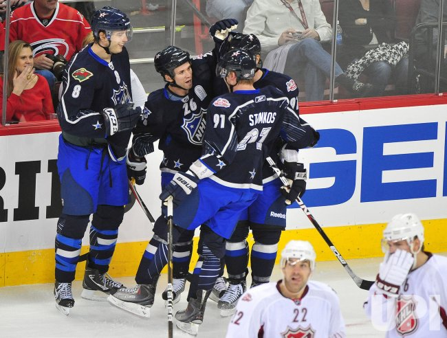 Martin St. Louis scores during the 2011 NHL All-Star Game