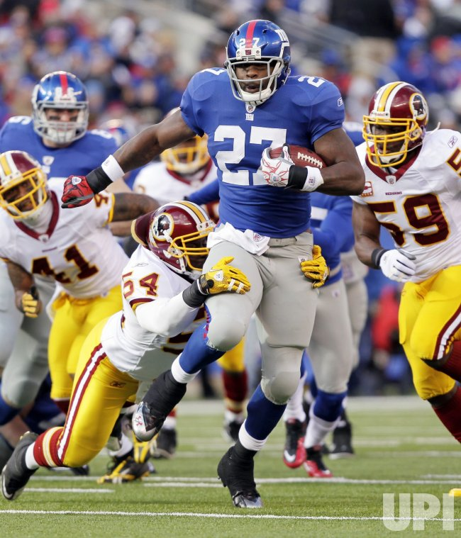 New York Giants Brandon Jacobs breaks a tackle from Washington Redskins H.B. Blades at New Meadowlands Stadium in New Jersey