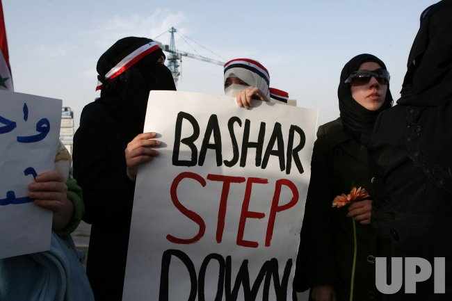 Syrian protesters call for Syria's President Bashar al-Assad to step down in Jordan