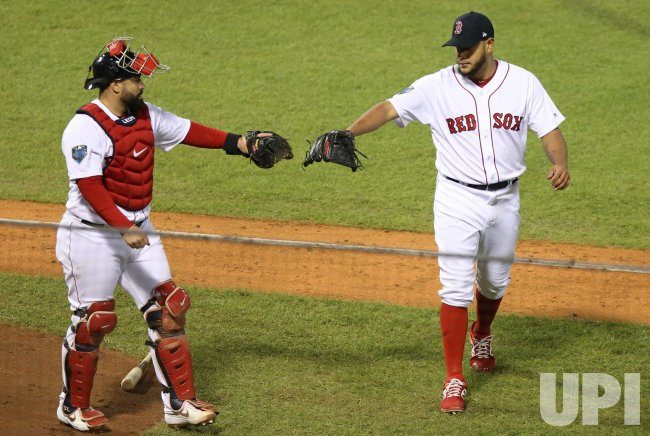 Red Sox pitcher Eduardo Rodriguez greeted by Sandy Leon during World Series