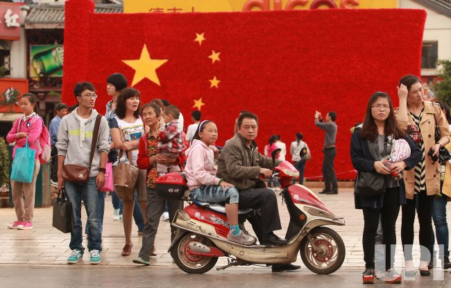 A giant Chinese national flag adorns a plaza in Kunming
