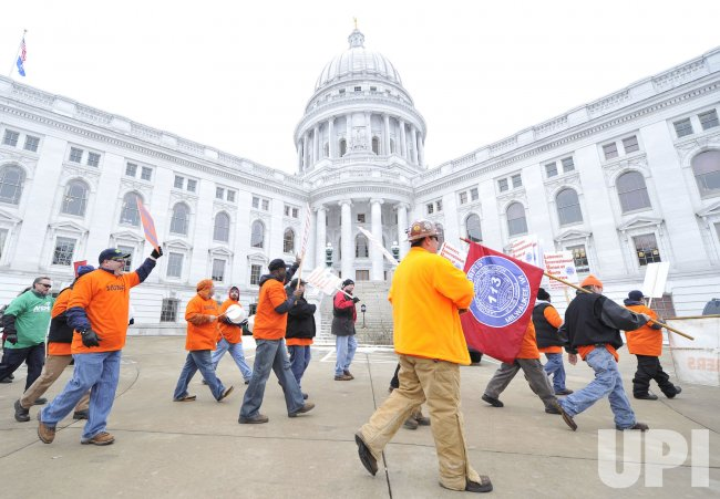 Protesters march around state Capitol in Madison, Wisconsin