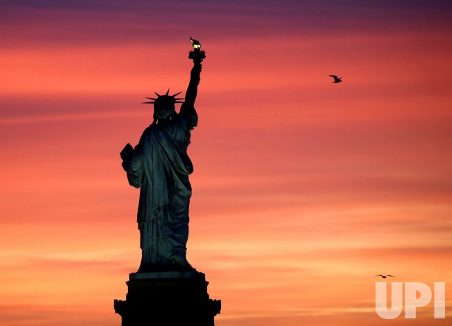 Sunrise Behind the Statue Of Liberty in New Jersey
