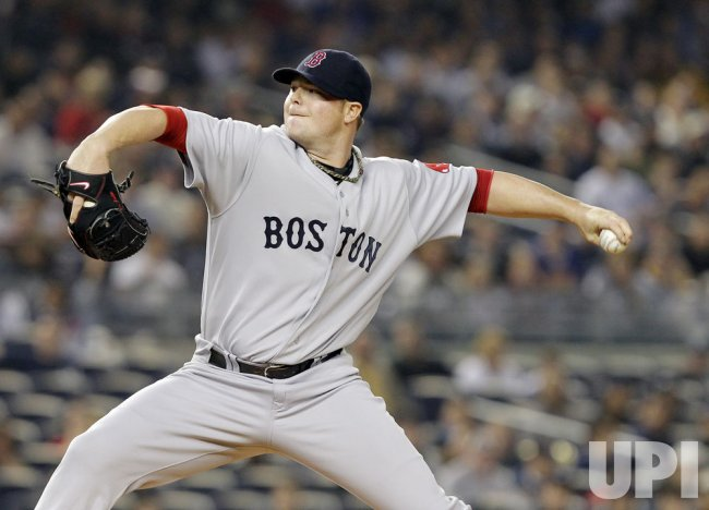 Boston Red Sox starting pitcher Jon Lester throws a pitch at Yankee Stadium in New York