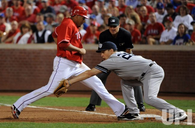 Yankees' first baseman Mark Teixeira tries to tag the Rangers Nelson Cruz