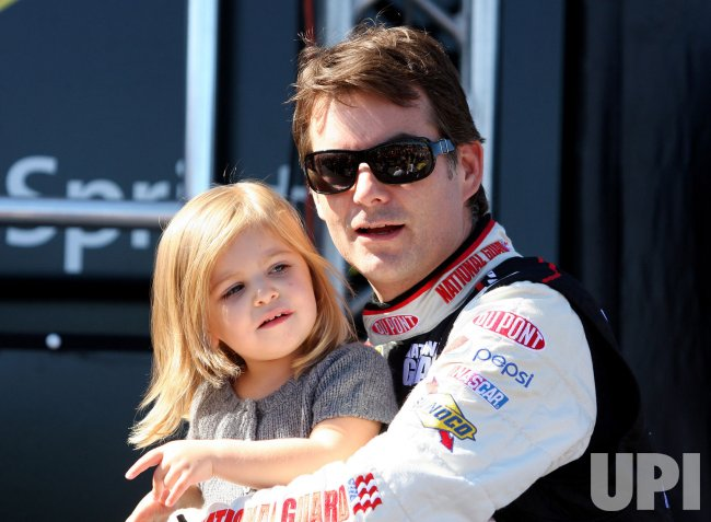 Jeff Gordon hold his daughter Ella Sofia at Loudon, New Hampshire