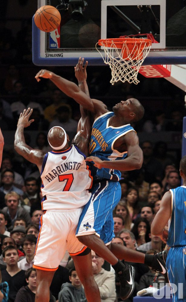 New Orleans Hornets Emeka Okafor blocks the shot of New York Knicks Al Harrington in the second quarter at Madison Square Garden in New York