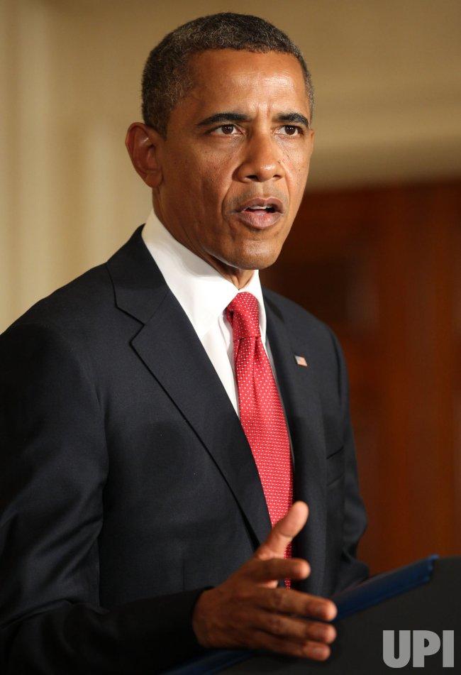President Obama signs HR 4348 in Washington