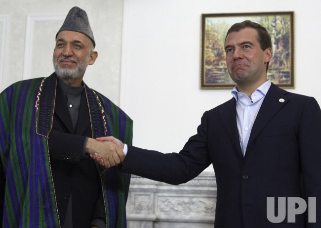 Russian President Medvedev meets with his Afghan counterpart Hamid Karzai
