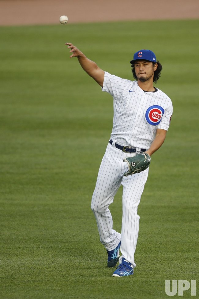 Cubs pitcher Yu Darvish warms up at Wrigley Field in Chicago