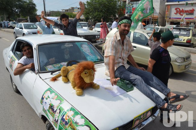 Pakistanis Celebrate after holding General Elections in Rawalpindi