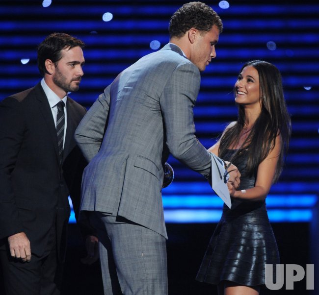 Jimmie Johnson and Emmanuelle Chriqui present award to Blake Griffin at the ESPY Awards in Los Angeles