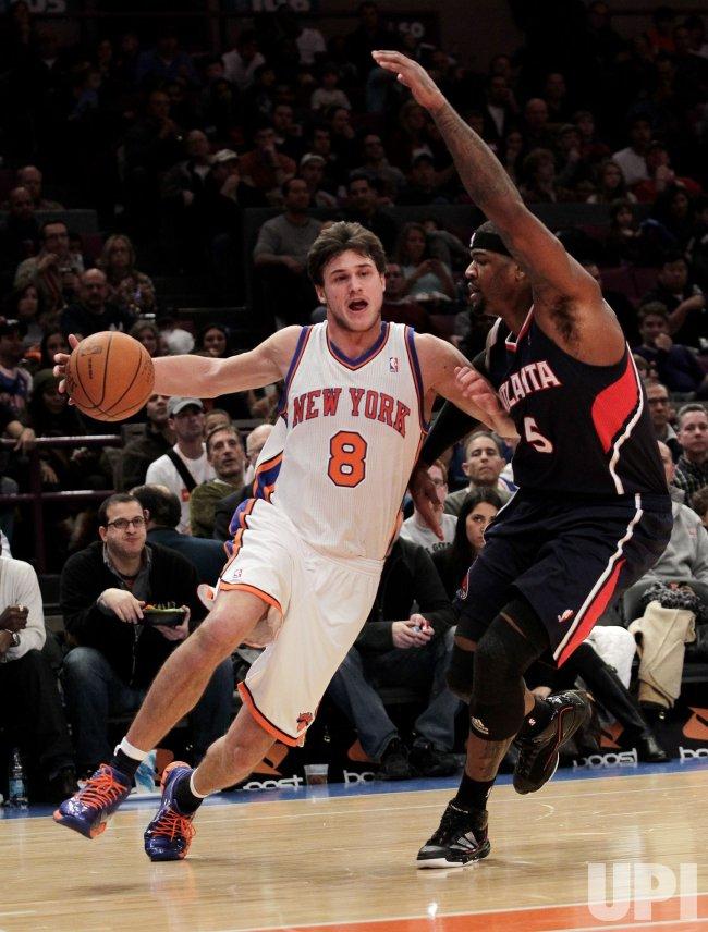 New York Knicks Danilo Gallinari drives to the basket by Atlanta Hawks Josh Smith at Madison Square Garden in New York