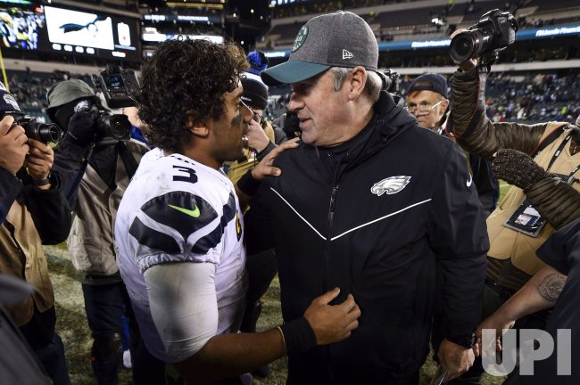 Russell Wilson (3) shakes hands with Eagles head coach Doug Pederson