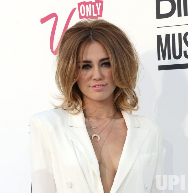 Miley Cyrus arrives at the 2012 Billboard Music Awards in Las Vegas, Nevada