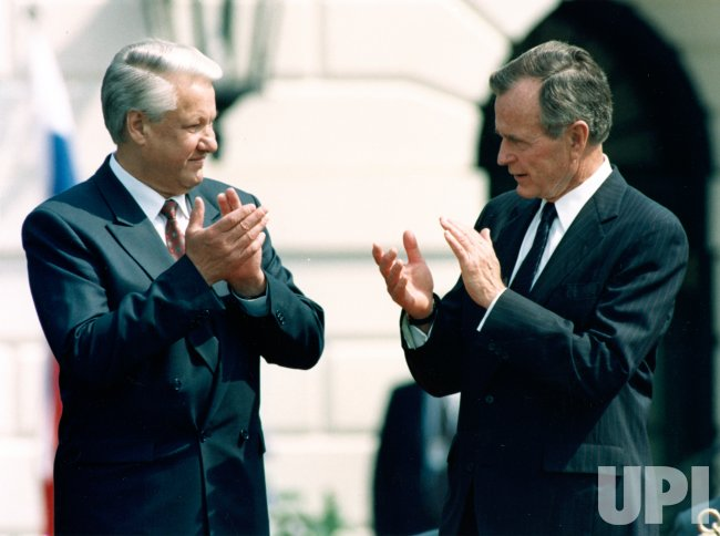 President Boris Yeltsin and President George Bush applaud one another during arrival ceremonies at the White House