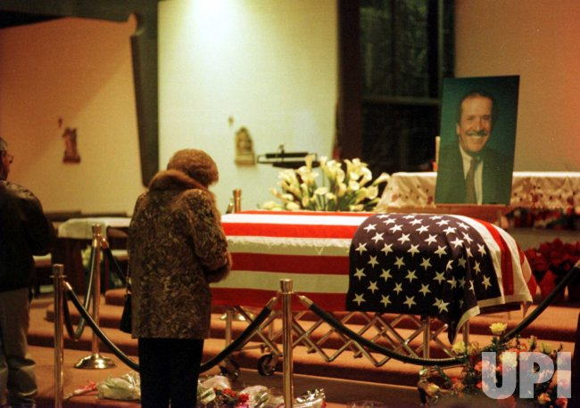 A mourner pays her last respects to the flag draped casket of entertainer and politician Sonny Bono