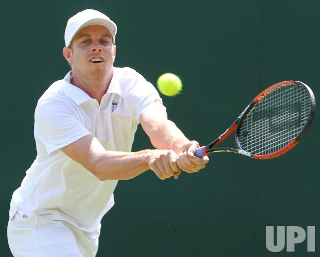 Sam Querrey plays a backhand on the second day of Wimbledon.