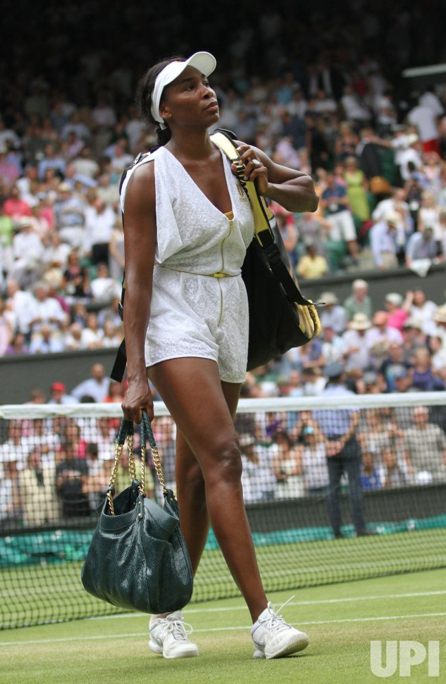 Venus Williams leaves Wimbledon.