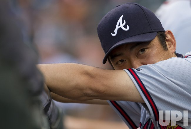 Braves Relief Pitcher Saito Sits in the Dugout in Denver