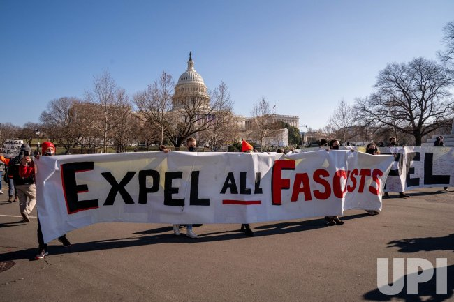 Activists Carry Signs Expel All Fascists