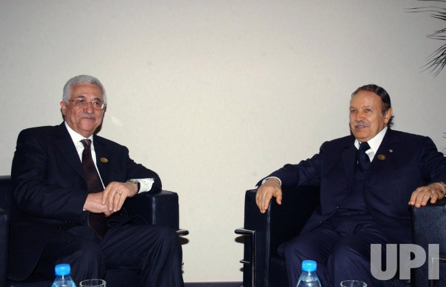 ABBAS ATTENDS COMMUNICATIONS SUMMIT IN TUNISIA