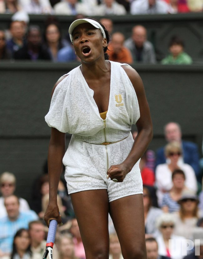 Venus Williams reacts at Wimbledon.